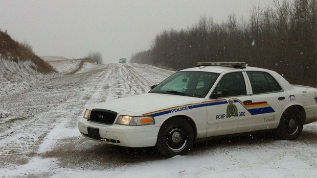 RCMP block a rural road near Ranfurly, AB where a body was found Saturday