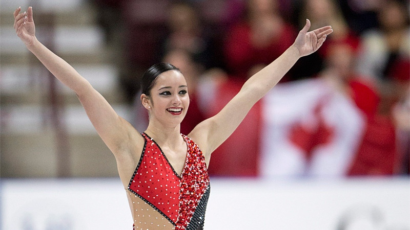 Canada's Kaetlyn Osmond salutes the crowd following her free program in the women's competition at Skate Canada International Saturday, October 27, 2012 in Windsor, Ont. Osmond won gold in the event. THE CANADIAN PRESS/Paul Chiasson