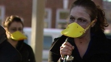 A woman dressed up as a zombie duck hopes a bit of embarrassment will shock the province into action.