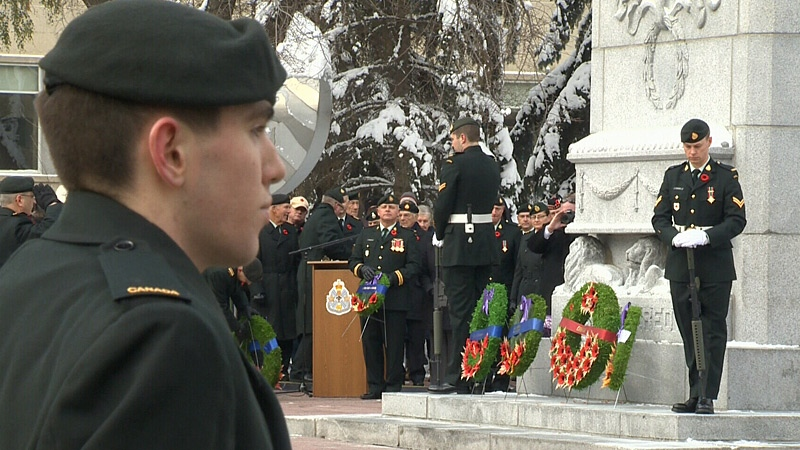 A wreath-laying service outside city hall on Remembrance Day.