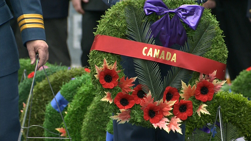 A Canada wreath is presented at a Remembrance Day ceremony at West Edmonton Mall on Nov. 11, 2012.