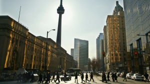 Commuters walk along Bay Street in downtown Toronto Tuesday March 12, 2002. (CP PHOTO/Kevin Frayer)
