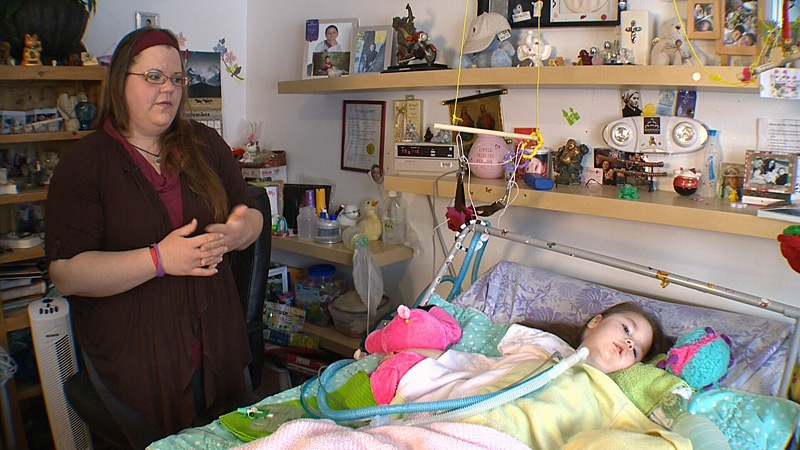 Lisa Lohin's four-year-old daughter Enna has spinal muscular atrophy and requires oxygen therapy in order to stay alive. Lohin says Alberta Health Services guidelines for oxygen therapy funding needs to be changed to better help families who need oxygen funding.