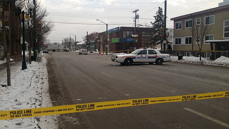 Police tape surrounds the scene of a suspicious death in the area of 107 Avenue and 104 Street.