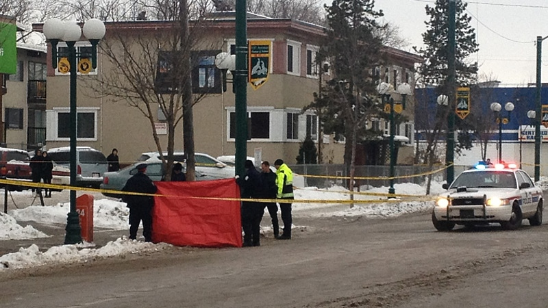Police at the scene of a suspicious death at 107 Ave and 104 Street. A man died on a sidewalk in the area early Saturday morning.
