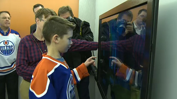 Ethan Lockwood, a patient of the Glenrose Rehabilitation Hospital, is the first to try new technology in the hospital's new Oilers Interactive Learning Centre.