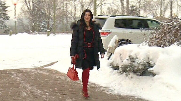 Tourism Minister Christine Cusanelli on her way into Government House in Edmonton for a Caucus Meeting on Thursday, December 6.