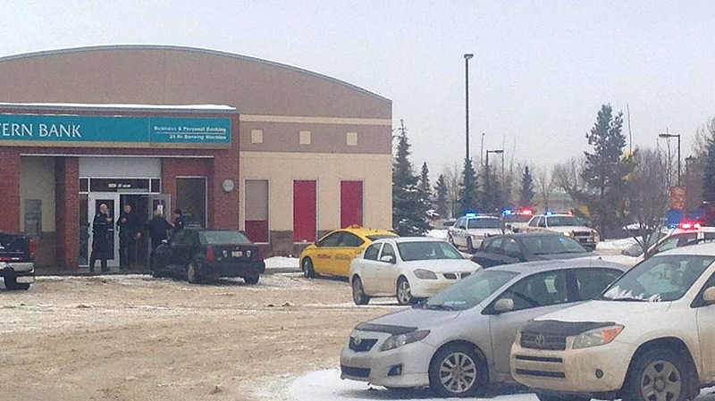 Edmonton Police on the scene of an armed robbery of a Canadian Western Bank located at 21 Ave. and 99 St. Courtesy: Morris Lo