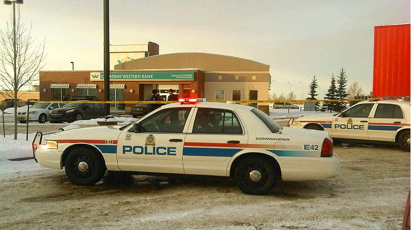 Edmonton Police on the scene of an armed robbery of a Canadian Western Bank located at 21 Ave. and 99 St. on Tuesday, December 11.