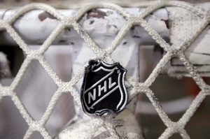 The NHL logo is seen on a goal at a Nashville Predators practice rink in this September 2012 file photo. (AP / Mark Humphrey)
