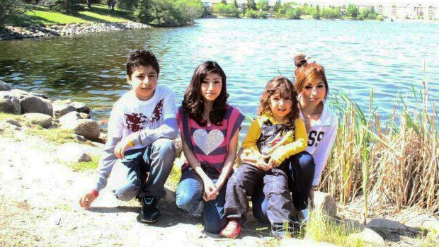 Zahra Easa, 13, is pictured with her family members in an undated photo provided by her family. SUPPLIED.