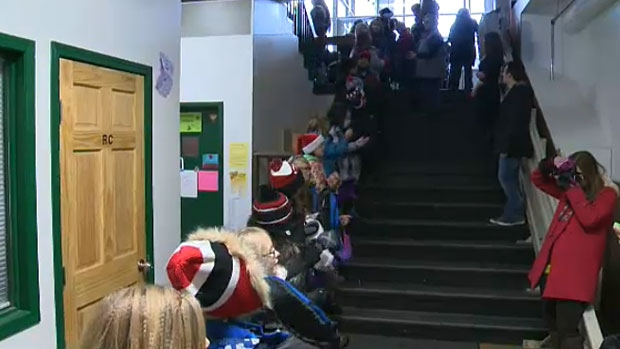 More than 100 students delivered backpacks filled with warm clothes and personal items to Edmonton's less-fortunate on Monday morning.