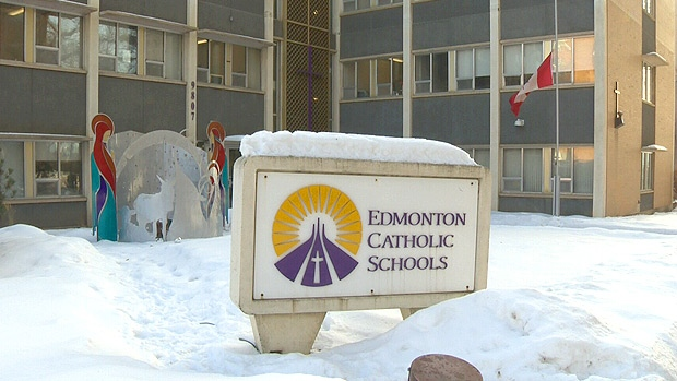 The Canadian flag in front of the Edmonton Catholic School District offices flies at half-staff on Monday, Dec. 17, 2012, to honour those lost in the shootings in Newtown, CT on Dec. 14.