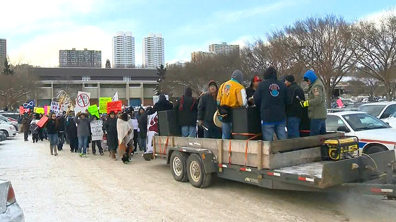 A trailer lead hundreds of protesters out of Kinsmen Park, through Edmonton's river valley towards Grierson Hill and Canada Place on Friday, December 21.