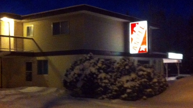 Police say a man barricaded himself in a motel room with a gun in Redwater, Alberta on Tuesday, Dec. 22, 2012.