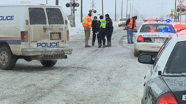 Officials are investigating after three contract CN rail workers were injured by an oncoming train Wednesday morning.