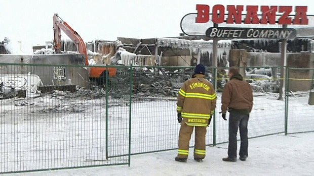 Investigators continue to comb through what is left of a north end strip mall after a Christmas Day fire.
