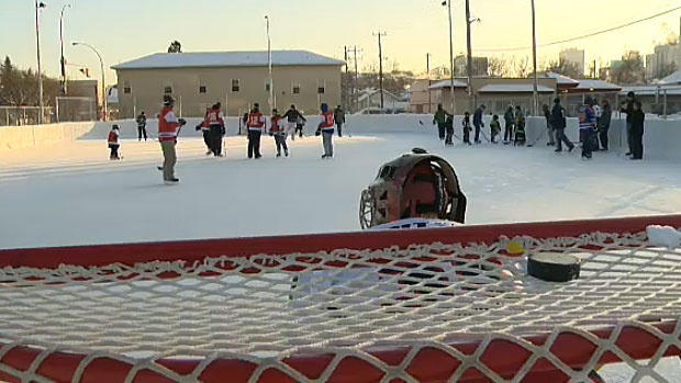 Dozens of kids in central Edmonton laced up their skates to compete with city police officers during an annual hockey competition Thursday, that aims to build relationships in the city's core.