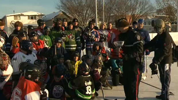 Youth from the McCauley neighbourhood got to pose with Edmonton police officers and Oilers alumni during the 4th annual McCauley Cup on Thursday.