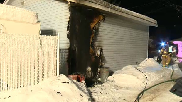 Police are searching for an arson suspect after three fires in north Edmonton early Thursday morning. In this picture, the sides of a garage at 124 Street and 134 Avenue were damaged before crews contained the blaze.