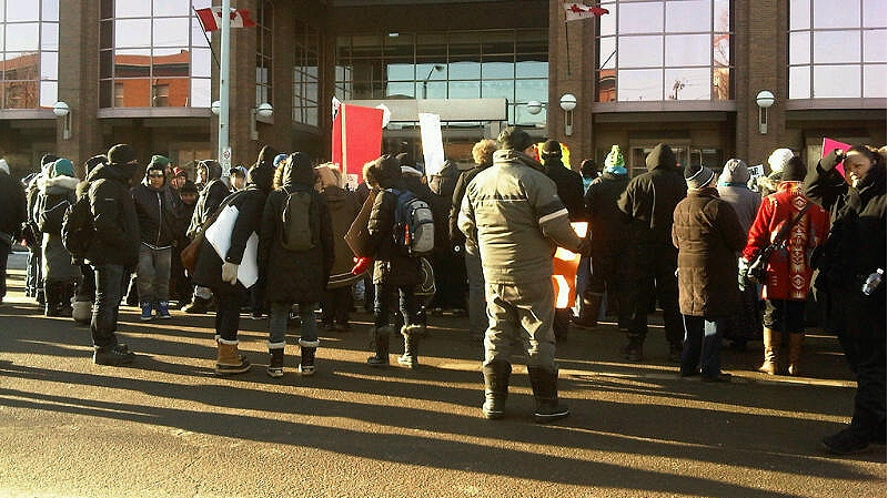 Dozens of Idle No More protestors gather outside of Canada Place in downtown Edmonton on Friday, January 11.