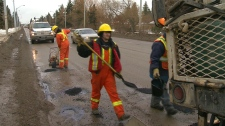 City Crews filling potholes