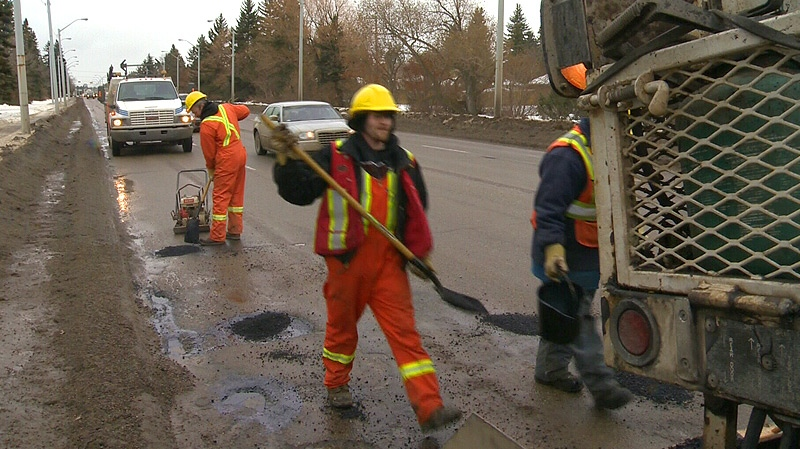 City workers were scrambling Wednesday, Jan. 16 to fill a number of potholes left behind after an unseasonable warm spell melted snow and ice on city streets.