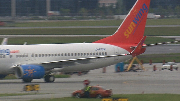 Passengers on Sunwing flight number 586 are upset that a number of delays doubled their travel time.