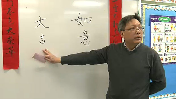 Teacher Stephen Tsang is showing students at Meadowlark Elementary School the art of Chinese calligraphy, something some say is considered a lost art form.