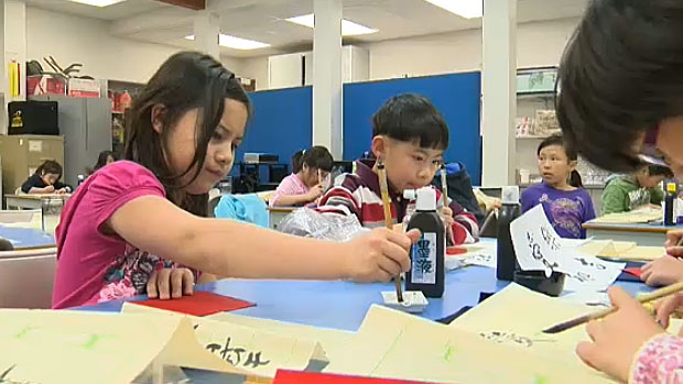 Students spend their lunch hour learning the ancient art of Chinese calligraphy at Meadowlark Elementary School.