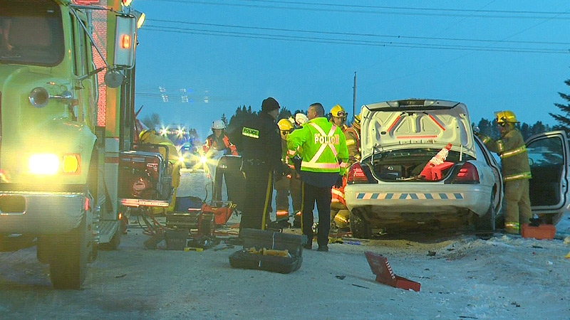 RCMP and emergency crews on the scene of a head-on collision between an RCMP officer's vehicle and a pickup truck on Thursday, Feb. 14.
