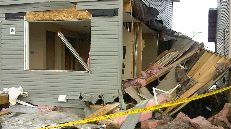 The explosion appeared to have blown out the entire back wall of the main floor of the home.