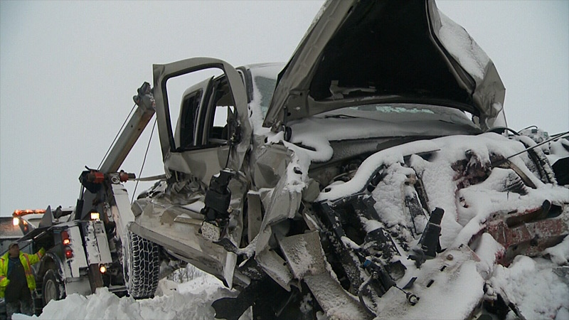 A damaged truck being towed away after a chain-reaction collision on the Queen Elizabeth II Highway south of Leduc on Thursday, March 21, 2013.