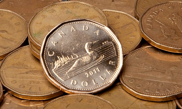 Canadian dollars are pictured in Vancouver, B.C. Thursday, Sept. 22, 2011. (THE CANADIAN PRESS / Jonathan Hayward)