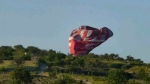 This image from video provided by E. Wayne Ross shows an Anatolian Balloons Company hot air balloon crashing near Göreme National Park and the Rock Sites of Cappadocia in central Turkey, Monday May 20 2013. (AP Photo/E. Wayne Ross)