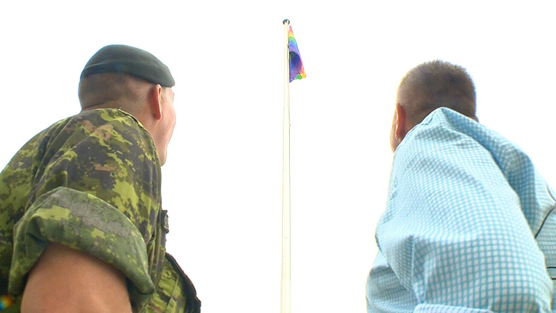 Master Warrant Officer John McDougall (L) and his partner Dave Gilbert (R) were watching as the pride flag was raised for the first time at CFB Edmonton Friday, June 7.
