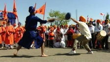 Members of Edmonton's Sikh community celebrate Vaisakhi in Mill Woods. The men pictured are performing Gatka, a traditional form of dance fighting on Sunday, May 22, 2011.