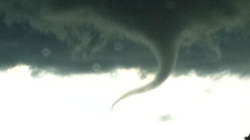 A funnel cloud is pictured east of Sundre, Alta. on Thursday, July 7, 2011. Image: Mike Crone.