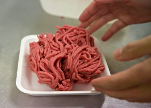 Fresh ground beef is packed at a local butcher shop in Levis Que. on Monday, October 1, 2012. (Jacques Boissinot / THE CANADIAN PRESS)