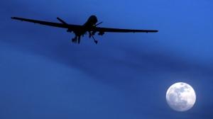 An unmanned U.S. Predator drone flies over Kandahar Air Field, southern Afghanistan, on a moon-lit night, Jan. 31, 2010. (AP / Kirsty Wigglesworth)