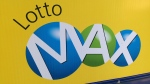 A sign outside a Toronto convenience store advertises a Lotto Max draw. (Chris Kitching)