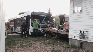 Family was having supper when St. Albert bus crashed into backyard