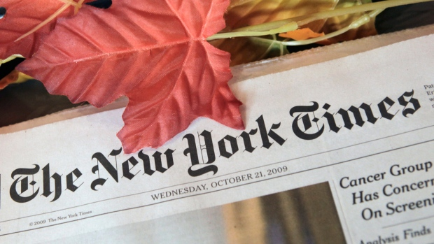The New York Times on a newspaper rack