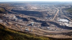 This aerial photo shows a tar sands mine facility near Fort McMurray, in Alberta, Canada. Alberta has the world's third-largest oil reserves after Saudi Arabia and Venezuela - more than 170 billion barrels. (Jeff McIntosh / THE CANADIAN PRESS)