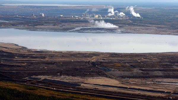 This Sept. 19, 2011 aerial photo shows an oilsands tailings pond at a mine facility near Fort McMurray, Alta. Researchers doubt that oilsands-damaged land can be restored to what it was (Jeff McIntosh / THE CANADIAN PRESS)