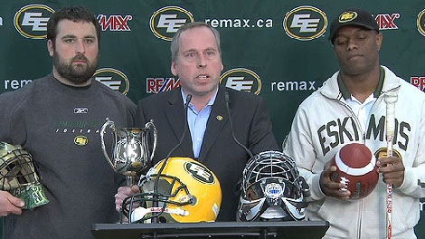 Edmonton Eskimos President Len Rhodes, flanked by offensive line (L) Gord Hinse and wide receiver Ed Hervey, announce the 'Edmonton Cup' in a still taken from video posted on the Edmonton Oilers website.
