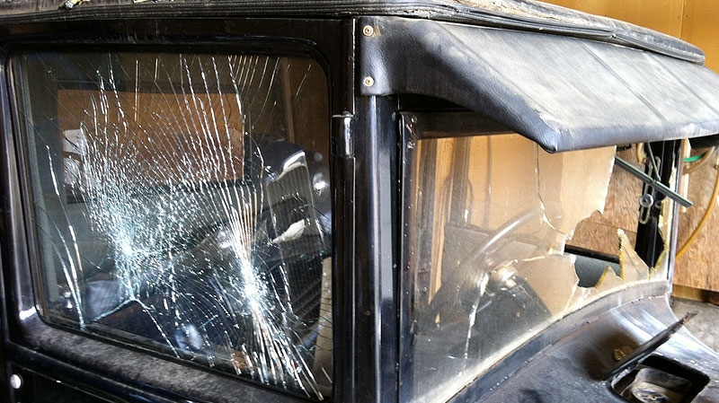 The windshield and windows of the 1925 Ford Model T were smashed in the incident. Thursday, April 19