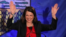 Wildrose Leader Danielle Smith waves to the crowd in High River, Alberta, Monday, April, 23, 2012. (Jonathan Hayward / THE CANADIAN PRESS)