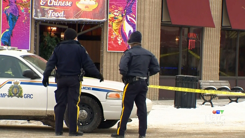Police at a restaurant in Fort Saskatchewan, where a man's body was found Tuesday morning.
