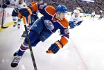In this file photo, Edmonton Oilers' Leon Draisaitl (55) chases the puck against the Vancouver Canucks during second period NHL hockey action in Edmonton, Alta., on Thursday, Oct. 2, 2014. (CP / Jason Franson)